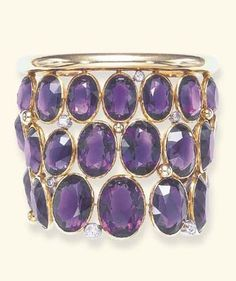 AN ELEGANT ART DECO AMETHYST AND DIAMOND BANGLE BRACELET, BY SUZANNE BELPERRON. Designed as a triple-row openwork oval-cut amethyst cuff, enhanced by old European-cut diamond collets and polished gold boules, to the polished and sculpted rigid gold band, mounted in gold, circa 1940. #Belperron #ArtDeco #bracelet
