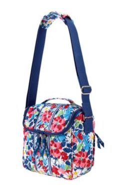 Vera Bradley Camera bag in Summer Cottage. Designed for an SLR camera and lens, this is a colorful spot for your colorful shots. A repositionable divider adjusts for a customized fit, while an interior zip pocket and rear back pocket hold memory cards and cords.