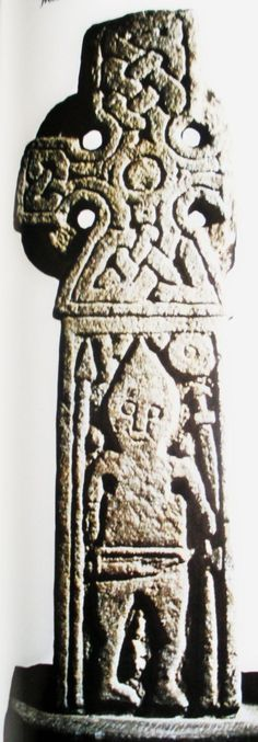 Black & white image of Cross B in St Andrew's church. Dating from the 9th century, it is an Anglian/Norse wheel-head cross with a Viking warrior carving. He is either seated on a throne, or lying in his coffin.