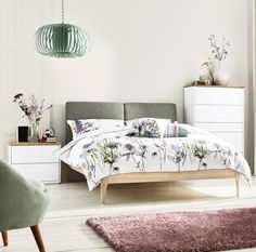 BEDROOM GOALS! Clean white furniture combined with pretty floral prints shout all things summer.