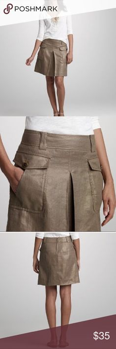 """J. Crew Burnish Linen Brass Cargo Skirt size 4. Burnished linen brass cargo skirt from J. Crew. Size 4. Excellent condition. A dressed-up take on a cargo style, in special Italian linen from the venerable Crespi mill (the oldest weaving mill in the world). The patinated effect is achieved by a closely guarded metallic-foil process. Slight A-line shape with inverted pleat in front. Sits just below waist. Belt loops and patch pockets with button closure. Back zip. 17"""" long( approx). Size 4…"""