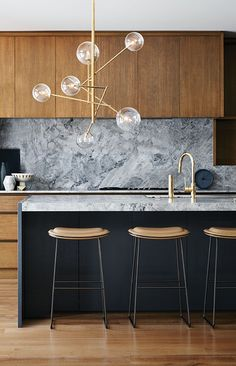 Grey Marble Backsplash, Natural Wood Cabinets, Modern Kitchen
