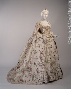 Wedding Gown, 1763. Robe a la Francaise. This wedding dress is one of the most outstanding garments in the McCord Museum's collection. A rare piece, it is one of the few 18th-century silk gowns with a hand-painted floral design to be found in a North American museum. The soft cream silk was handwoven in China, where the floral pattern was handpainted in tones of lavender, blue, yellow, green and brown. This charming dress was worn by Mary Chaloner in Guiseborough, England, when she married.
