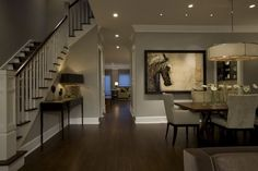 gray living room with dark wood floors | Dark Wood Floors, white trim, gray walls by Ros