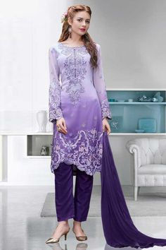 Purple Georgette Trouser Suit With Dupatta Purple Georgette, semi stictch trouser suit. Allover embroidered with embroidered, resham, zari and stone work. Asymmetrical neck, Below knee length, full sleeves kameez.  Purple santoon trouser.  Purple chiffon dupatta with lace border with work.
