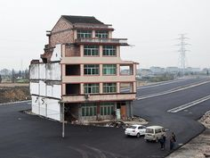 Chinese couple refuse to leave their home
