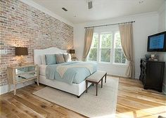 brick wall, nightstands with mocha lampshades