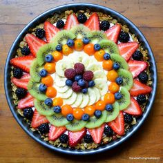 Beautiful Breakfast Tart - uses granola baked into the pan, Greek yogurt, and layered fruit. Healthy, pretty and delicious!