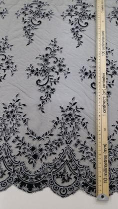 Black with white lace fabric. Both sides scalloped. Width: 150 cm/59.1 inches Item number: EVS073C Price is set for one meter/yard. You will receive the fabric in one continuous piece if you purchase more than 1 meter/yard. You can purchase a sample here: https://www.etsy.com/listing/219262408/buy-a-swatch-sample?ga_search_query=sample&ref=shop_items_search_1 If you need a different amount, please contact us. We offer special discounts...