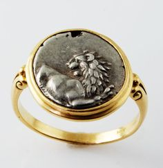 Ancient Lion Coin Ring        Model: 630-82    18k Yellow gold ring featuring an ancient Greek coin from Thrace, Cherronesos, 350-300BC.    Finger size 7.5