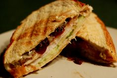 HeatherGanterRecipe - Turkey Panini with Onion-Cranberry Marmalade: 4 slices (3/4 inch thick) bread (multigrain, french... w/e),  4 slices cheese (Havarti is recommended, I used American, classy I know),  plenty of slices of deli turkey meat (3-4 per sandwich),  onion-cranberry marmalade,  1/2 small Granny Smith Apple, cut into thin slices.    Onion-Cranberry Marmalade: (courtesy of Pampered Chef)  Pour 2 tbls of hot water over 1/4 cup sweetened dried cranberris; let stand 5 minutes…