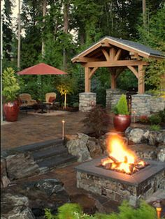 Custom Fire Art in Missoula, MT - great hardscape, firepit, and log constructed patio