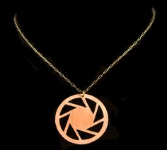 Aperture Science copper logo necklace... something other than copper though...