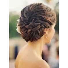 curly bridal updo hairstyle with flower