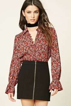 A semi-sheer woven top featuring an allover floral print, a button-down front, a basic collar, long sleeves with elasticized trumpet cuffs, and a flowy silhouette.