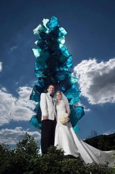 Donnie ('10 '13) and Christina Stanovcak ('09) posing in front of the Chihuly Sculpture at UAkron