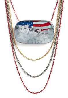 This appears to be Mount Rushmore, made out of cats, in front of an American flag. I can't even.