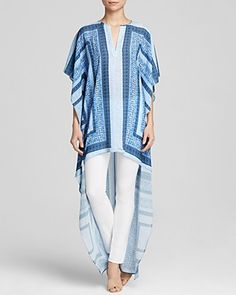 Spring 2015 sings a bluesy, bohemian tune, and BCBGMAXAZRIA is right on key. Here, a dramatic hemline and scarf motif revamps this billowy tunic, while varied shades of sky blue hit a high note for the season. #100PercentBloomies