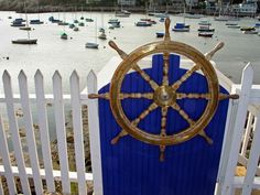 Great way to customize a white picket fence with this ship wheel.