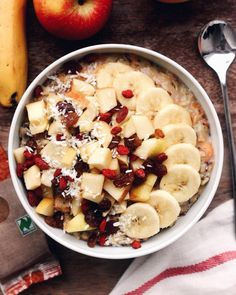 warm bowl of date sweetened carrot cake oatmeal with banana, apple, raisins, goji berries and coconut http://a-spoonfulofhealth.tumblr.com