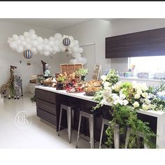 Today's set up at home for my gorgeous boy Isaac's 2nd birthday.  Our breakfast bar was a grazing station by my talented friends at @knifeandbarrel . So yummy !! Styling and setup @dianekhouryweddingsandevents @maryronisevents @crazyaboutflowers #isaacsturningtwo #hotairballoon #isaacjacob #animalprop #grazingstation #antipastio #cheesestation #kidsparty