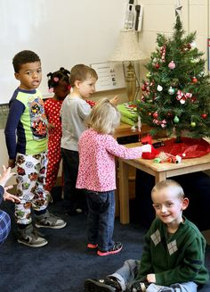 St. Ambrose students create interactive tree for preschoolers: Unlocking the magic of a very special Christmas tree in special education teacher Kristen Taft's classroom at Children's Village West on Thursday was as simple as pressing a button.