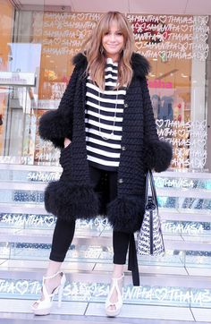 In the most 2009 of outfits, Lopez was all for fluffy details, sky-high heels, oversized hoop earrings and strands of pearls for this promotional visit to Japan.