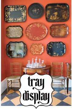 The orange wall makes the trays look spectacular.