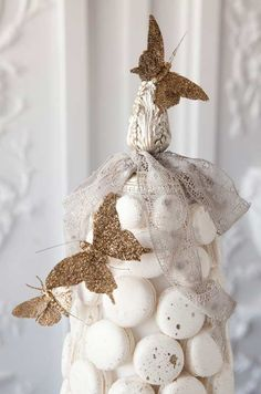 Shimmering butterflies and vintage lace ribbon combine for a chic mix of old and new.