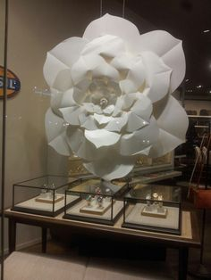 Fossil window display - beautiful large scale paper flower backdrop. #retail #merchandising