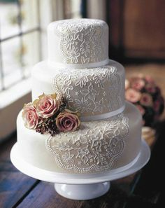 pretty flower lace wedding cake-purple flowers? pearl detailing instead of ribbon on the bottoms of each tier