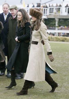 Princess Katherine looking stunning in a longline coat teamed with a beautiful sable fur headband #KateMiddleton