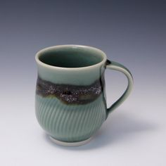 Wheel Thrown Porcelain Mug Celadon and Tenmoku Glazes with Chattering Texture by Hsin-Chuen Lin