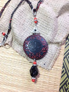 Large Asian Style Pendant Crocheted Bead Chain Assemblage Necklace Faux Cinnabar Chinese Black Red Bead Rhinestone Silver  WishAnWearJewelry by WishAnWearJewelry on Etsy