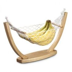 Laying in a hammock while wrangling a simple book is often a challenge, which explains why hammocks replacing desks in offices never caught on. Here's a nice compromise, though: A compact hammock for your feet that hangs under your desk and raises or lowers to put you in a working or slacking mood as needed.