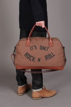 Lochie and I were discussing man bags this week, I think I talked him into them but not in a million years do I think he would carry this around. Shame really, I love it.