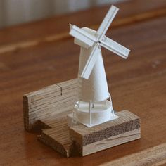 Com pequenas e delicadas esculturas de papel, este artista está construindo uma cidade Esculturas de papel 6
