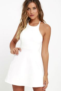 The Soft Strumming Ivory A-Line Dress is one of those numbers that always seems like the perfect thing to wear! Medium-weight knit forms a princess-seamed bodice with a strappy open back above a darling A-line skirt.
