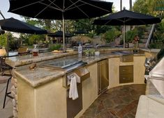 Modern Outdoor Kitchen That Lets You Party With Ceramic Table Bar Table Stove Black Umbrella Refrigerator Stone Floor Rustic Outdoor Kitchens, Modern Outdoor Kitchen, Patio Kitchen, Rustic Kitchen, Luxury Kitchen Design, Luxury Kitchens, White Kitchen Counters, Kitchen Black, Smart Kitchen