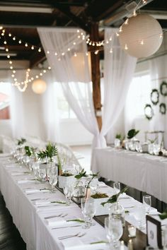 Minimalist white and green wedding reception | Image by Marisa Albrecht