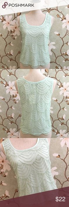 F21 Mint Colored Sleeveless Beaded Top Forever 21 mint colored beaded sleeveless top. NWT. True to size, lining is opaque. Slight scallop detailing around the hem. Forever 21 Tops Tank Tops
