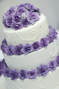 3 tier wedding cake with purple roses **Cakes by Bonnie