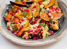 Quinoa with Acorn Squash and Pomegranate from A Thought For Food Quinoa with Acorn Squash and Pomegranate from A Thought For Food I'd call this dish a happy accident. Here's the short version of a long story. There were plans to roast a whole eight pound fish at our Friendsgiving dinner