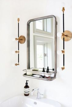 Modern bathroom features a Restoration Hardware Astoria Mirror with Shelf illuminated by brass linear sconces Apparatus Studio Vanity Sconces over a pedestal sink. Bad Inspiration, Bathroom Inspiration, Small Bathroom, Master Bathroom, Bathroom Mirrors, Bathroom Ideas, White Bathroom, Brass Bathroom, Ikea Bathroom