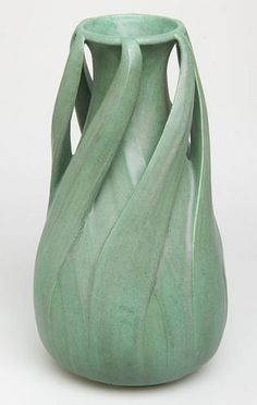 Teco Pottery circa 1915 – Around 1885, William Day Gates established Gates Potteries in Crystal Lake, Illinois. After years of trial and error, he developed a cool, silvery green matte glaze that resembled the tones of aged bronze. Combining the first let