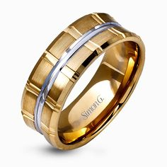 Two wide rows of sleek yellow gold are married with an elegant center cable of striking white gold in this arresting men's wedding band.