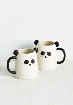 Rise and shine with a cup of cuteness, thanks to this delightful duo. Boasting an adorable pair of pandas with perky ears and a smooth matte finish, these quirky mugs add a touch of charming animation to your kitchen or desk!