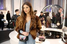 Fashion influencer @negin_mirsalehi enjoys the #bubbleoftime atmosphere while sporting a special preview of the #furla90anniversary capsule collection - her flap is from the '50s!  #furlafeeling #MFW17 #fashionweek #neginmirsalehi