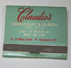 """Foot of Main Street, Greenport NY. Claudio's Restaurant and Marina. Marina Phone (516) 477-0355. American Match Co. New York, NY. Used cover with wear and discoloration. """"Long Island's most famous seafood house"""""""