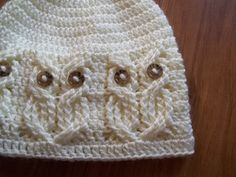 """It's a Hoot!,, A beanie style hat done in beautiful cables to create an owl pattern all around the brim. The """"owls"""" eyes are buttons which are attached during the actual crochet work and not sewn after. So no sewing on later!!! Standard 5/8 Inch buttons were used, but pony beads may be used as well. You can find glow in the dark pony beads inexpensively at Walmart and those could be used for the eyes,, how fun!!!"""